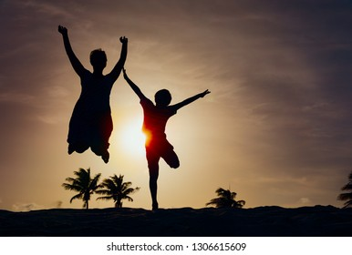 mother and son play at sunset, family enjoy tropical vacation