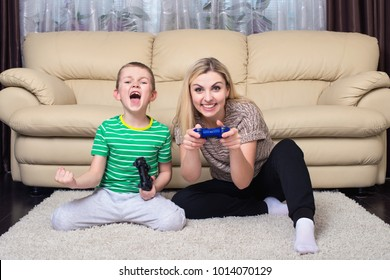 Mother and son play video games together.