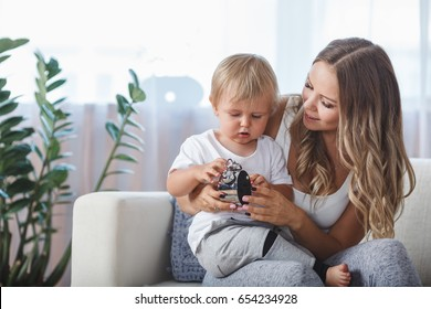 mother and son playing with alarm clock