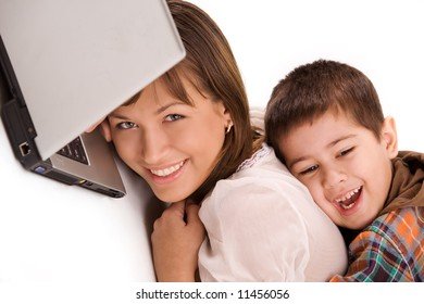 Mother and son playing with laptop over white background