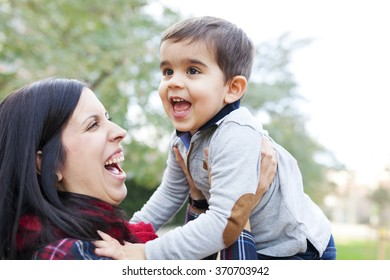 mother and son playing in the park