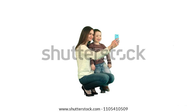 Mother And Son Posing For Selfie  on white background isolated