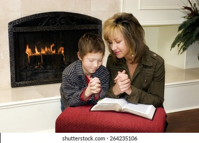 Mother And Son Praying Together