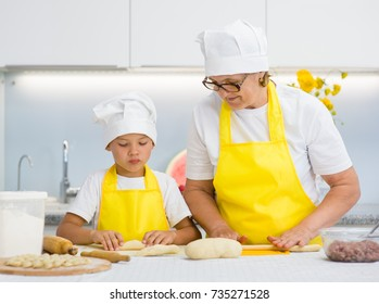 Mother and son prepare food at home in the kitchen