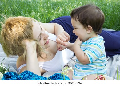 Mother with son relaxing at the park