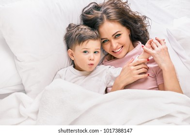 Mother and son resting