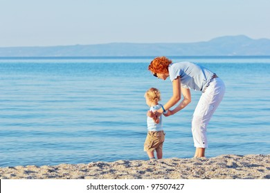 Mother and son resting at the beach in summer