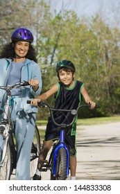 Mother and son riding bicycles