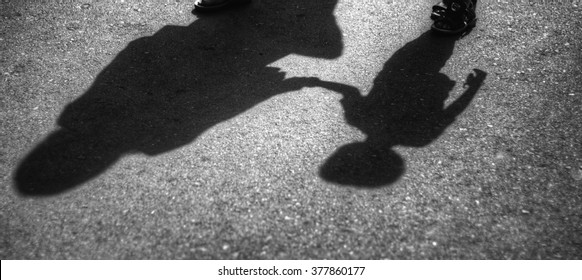 Mother and son shadows