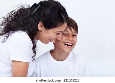 Mother and son sharing a funny moment laughing with joy