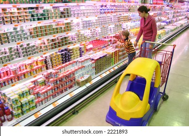 mother with son in shop