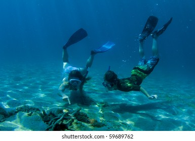 Mother and son snorkelers observing interesting underwater life. Picture taken in Palm Beach County, Florida.