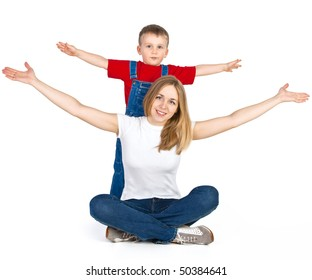 Mother and son spreading out their arms like flying plane