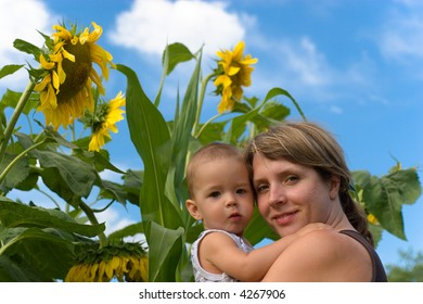 Mother, son and sunflower
