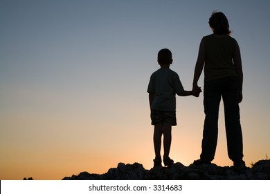 Mother and son at sunset.