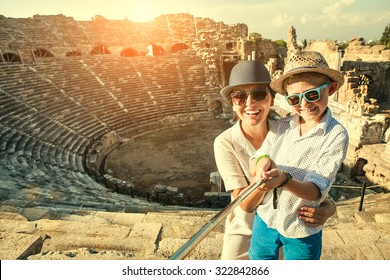 Mother with son take a selfie photo in antique theatre