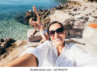 Mother with son take vacation selfie photo in Adriatic Sea Bay