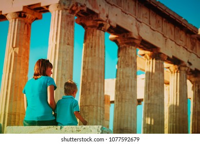 mother and son travel in Greece, lookint at ancient buildings