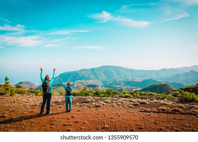 mother and son travel in nature, family hiking in mountains