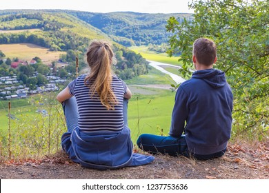 Mother and son viewing dry Edersee in german landscape