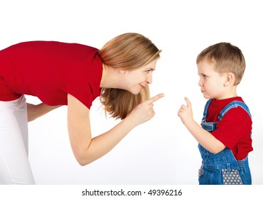 Mother and son wag their fingers to one another