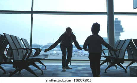 Mother and son waiting for flight.