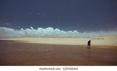Mother and son walkin on Laguna de Rocha, Rocha, Uruguay
