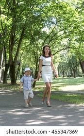 Mother and son walking on a footpath in the Park