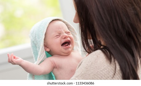 Mother soothing her crying baby