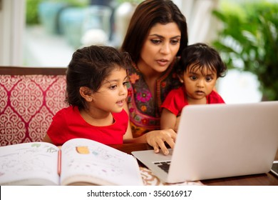 Mother spending time with her two children, focus on little girl