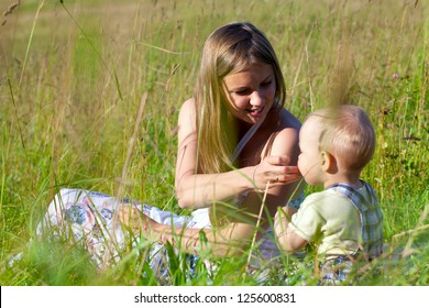 mother and sun on summer field