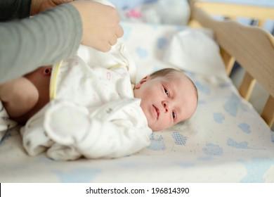 mother take care of tiny newborn