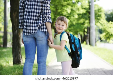 Mother taking daughter to school