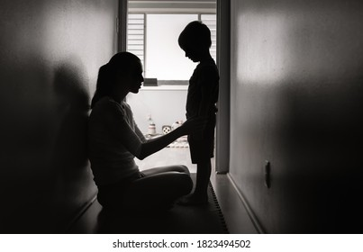 Mother talking to her child at home. Correcting, and disciplining children concept.