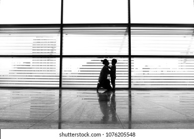 a mother was talking to her son in one of the hotel loby in surabaya east java indonesia. on January 30, 2017