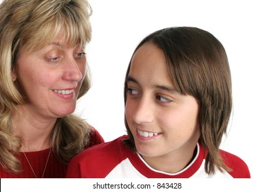 A mother or teacher looking suspiciously at a boy, who is wearing a mischievous expression.