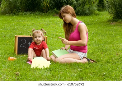 mother teaches daughter count. Early child development