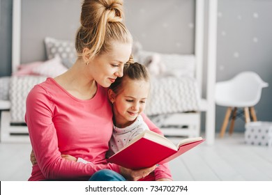 Mother teaches her daughter to read, They read books together, Relationships between parents and children, Education, Comfortable domestic life