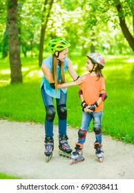 Mother teaches her daughter to ride roller skates