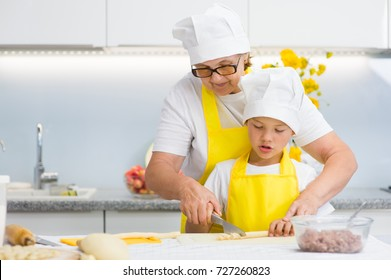 Mother teaches her son how to cook food in the kitchen. Space for text.