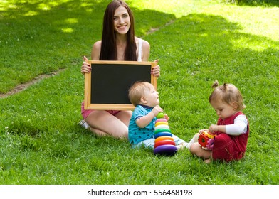 mother teaches her young children. Early child development