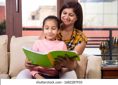 Mother teaching daughter at home
