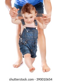 Mother teaching her cute little son to walk, holding hands, body part, isolated on white background, first baby steps concept