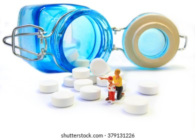 Mother is teaching her son to take medicine. (paracetamol bottle on white background)