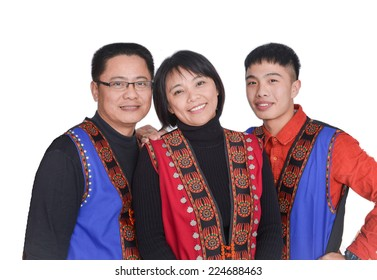 Mother with mother teenage kids in traditional dress face on white background