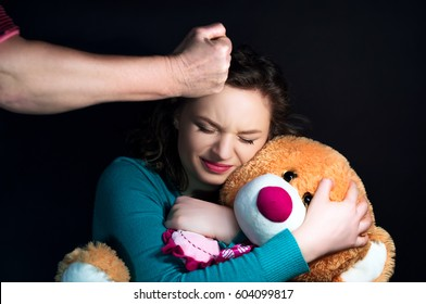 Mother threatens to hand a child a teenager on a black background