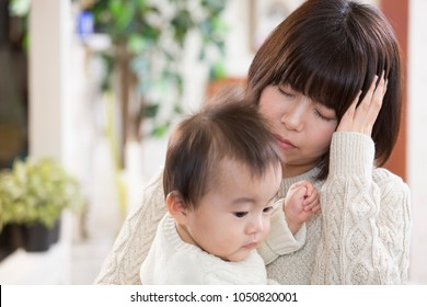 Mother tired from child rearing