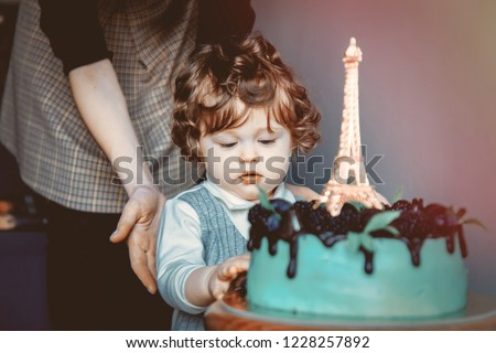 Mother And Toddler Boy With His First Cake On Birthday Is Eiffel Tower