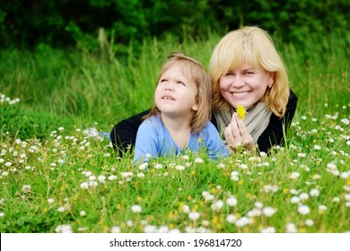 mother and  toddler girl on the meadow