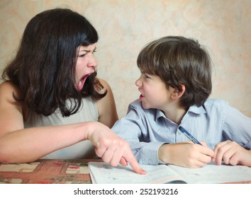mother try to help her son to do difficult task exercise and quarrel